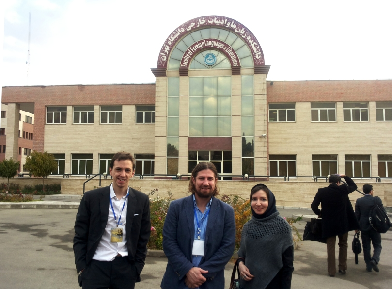 Outside the University of Tehran's Faculty of Foreign Languages and Literatures, accompanied by two colleagues